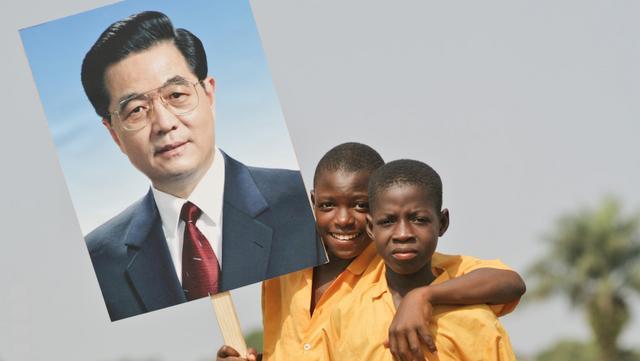 아프리카어린이와후진타오.jpg