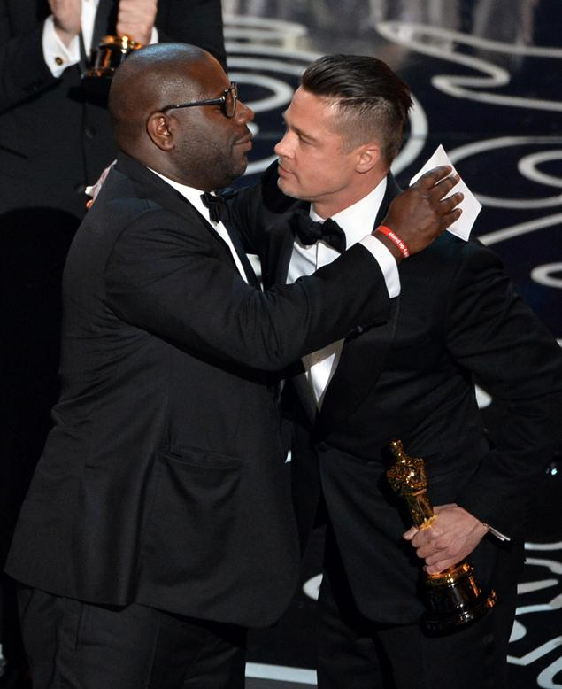 HOLLYWOOD, CA - MARCH 02: Director Steve McQueen (L) and actor/producer Brad Pitt accept the Best Picture award for '12 Years a Slave' onstage during the Oscars at the Dolby Theatre on March 2, 2014 in Hollywood, California. (Photo by Kevin Winter/Getty Images)
