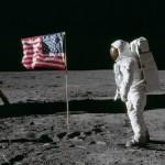 on-moon-next-to-flag