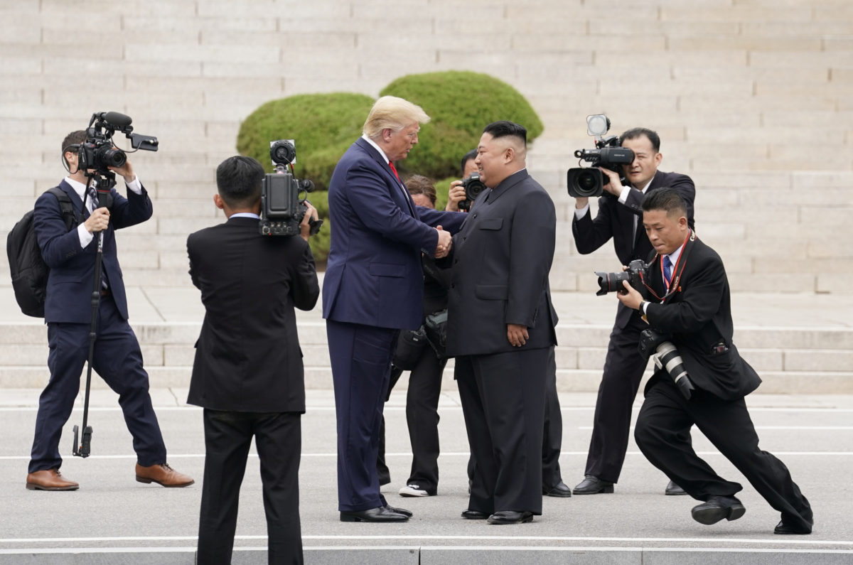 U.S. President Donald Trump meets with North Korean leader Kim Jong Un at the demilitarized zone separating the two Koreas, in Panmunjom, South Korea, June 30, 2019. REUTERS/Kevin Lamarque - RC1D3F626300